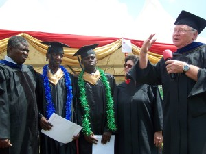 Bishop Dr. Isaac Wawire, top graduates-Tazo and Javan and the McDowell's